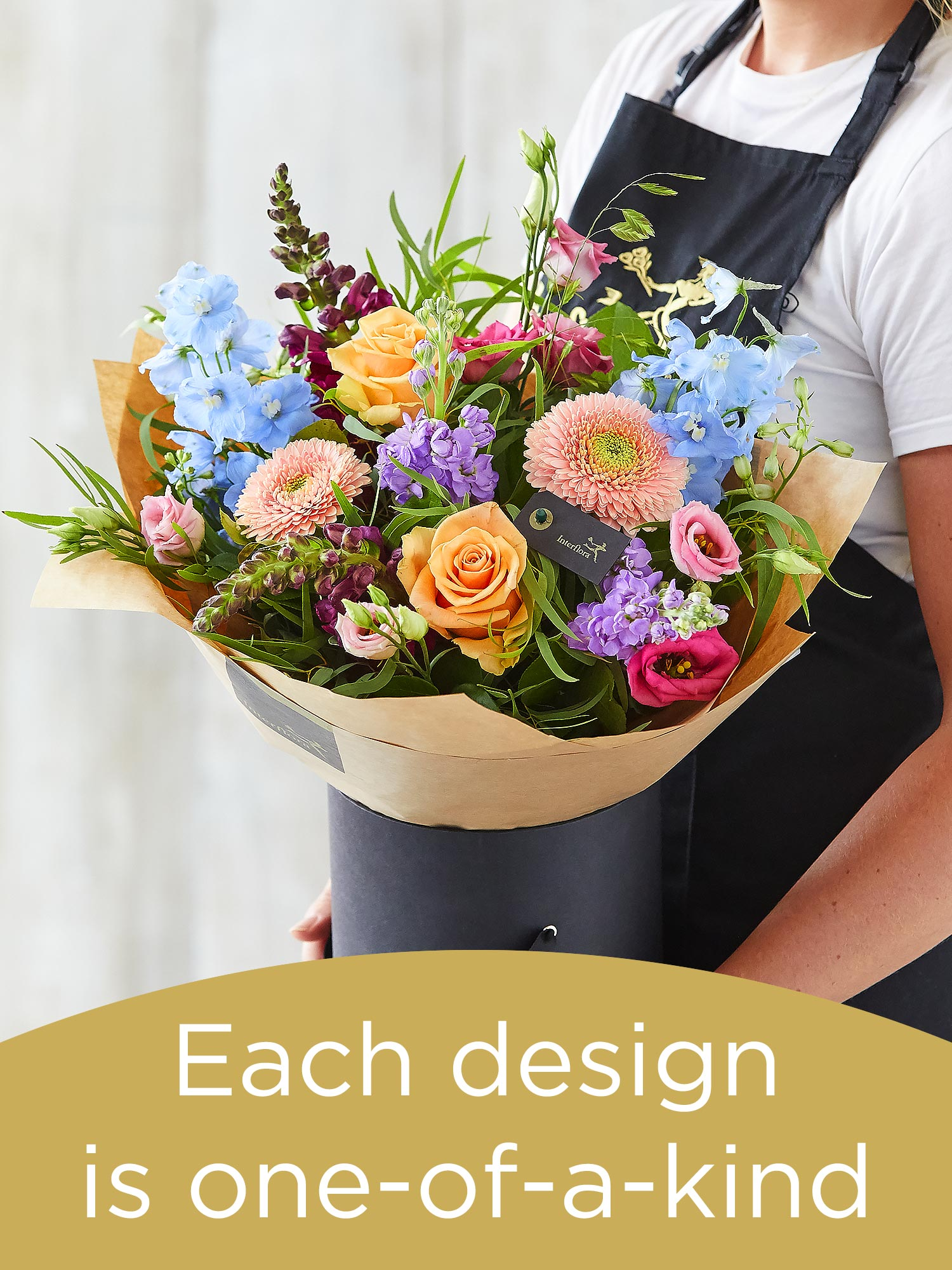 Arrangement made with seasonal flowers Flower Arrangement