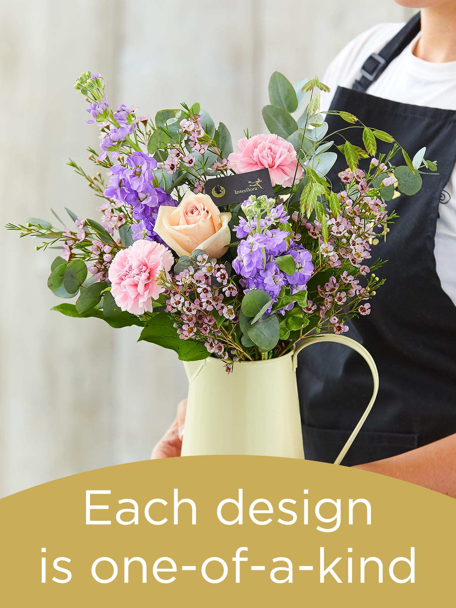 Hand-tied bouquet and vase made with seasonal flowers Flower Arrangement