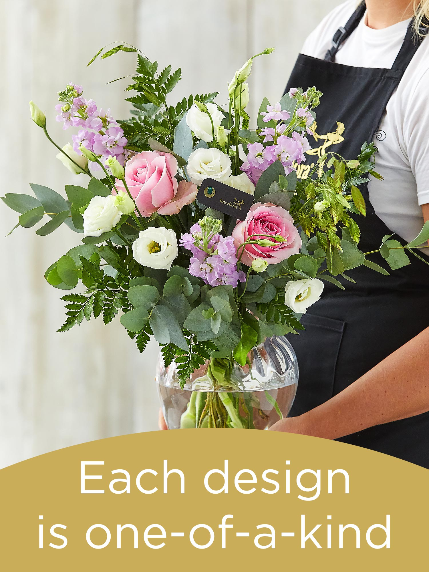 Bouquet and vase made with seasonal flowers Flower Arrangement