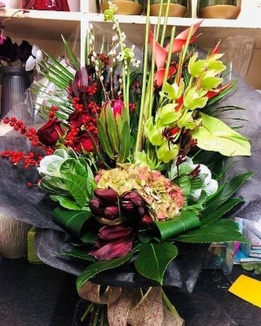 Red and Green Show Stopper Flower Arrangement
